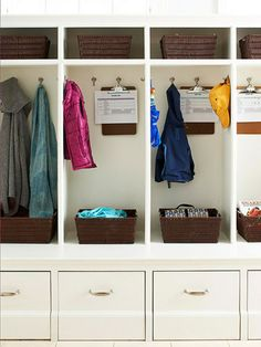 Individual Lockers-  Personal cubbies make it easy for the whole family to access and organize coats, bags, books, and shoes. Plus, they give young family members a sense of ownership that encourages them pick up after themselves. To get everyone on the same page about household chores, hang a weekly to-do checklist from a clipboard inside each cubby