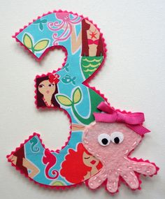 6 Inch Iron On Number with Pearl the Octopus. $9.00, via Etsy. I could probably make this