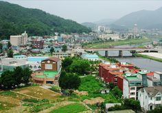 Dongducheon, South Korea.  This was my home for 4 months... I lived in an apartment building on the left side of the bridge.