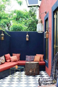 Painted walls and morrocan lanterns on the patio
