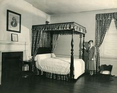 C. 1952 Mrs. B. Lamb of the APVA poses in the Master Bedroom