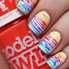 This sugar spun nail design looks fabulous in rainbow colors. Create it yourself with this tutorial.