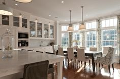 Beautiful, light-filled kitchen/dining area; white cabinets