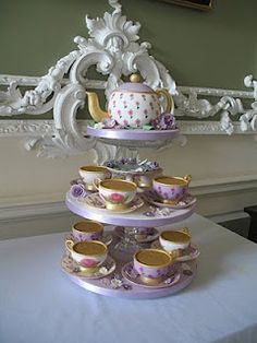 THIS IS A WEDDING CAKE!!  tea pot cake with tea cup cakes and sugar paste saucers, hand painted with food coloring, entirely edible