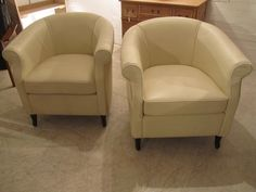 a-pair-of-deco-leather-armchairs