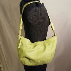 """The Sak Lime Green Leather Bag The Sak Lime Green Leather Bag in good used condition. There is a small scuff mark on the bottom. It has a zipper top closure and measures 10"""" x 14"""".  Please let me know if you have questions. Happy Poshing!!! The Sak Bags Shoulder Bags"""