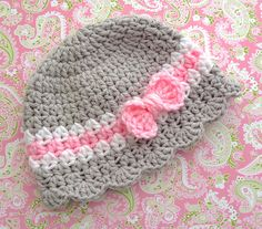 Baby Girl Hat With Bow Pattern #7 pattern by Lisa Corinne Crochet available for purchase on Ravelry. Such sweet colours and the cutest bow ever!