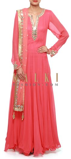 Buy Online from the link below. We ship worldwide (Free Shipping over US$100). Product SKU - 308385.Product Link - http://www.kalkifashion.com/coral-pink-suit-adorn-in-mirror-embroidery-only-on-kalki.html