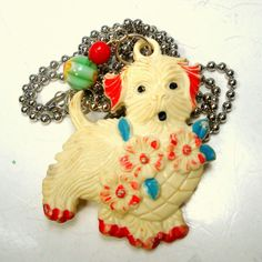 1940s White Dog Pendant on Chain, Funky Shabby Handpainted Pooch Cutie, Wearing Flowers, Crayola Bright Vintage Early Plastic Fun Brooch Cottage Chic Brooch, For The Cutie Critter Lover This dog is wearing a garland of flowers around his or her neck Love I guess. too cute!!!! This very early pendant is not perfect, the colors are rubbed, the back has a dark spot on the head but such a vintage sweetie I added beads and a silver ball chain, You can cut the chain to any length. Right now the…