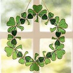 Shamrock Stained Glass Wreath -- A wreath of shamrocks means a wealth of good luck! Old Irish saying rings true today. Sun shimmers through handcrafted stained glass wreath of 12 clovers all hand-set in gold-tone metal frame.