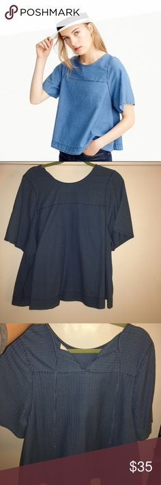 """J.Crew Swing Top Size Large. Indigo. Such a beautiful fun boho top. NWOT.       Never worn. No long Available.                                                           """"This swingy silhouette (crafted in a special indigo herringbone fabric from Spain) was inspired by a vintage top from the '70s that our designer discovered at a flea market in Brooklyn—so you can consider it pretty one of a kind. We recommend wearing it with high-waisted anything, now and later."""" J. Crew Tops Blouses"""