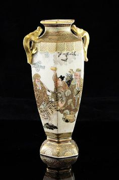 A Japanese Satsuma pottery hexagonal baluster vase, Meiji period, painted with Kwannon and other immortals in a landscape, within brocade pattern borders, the shoulders with dragon handles, two character seal mark to base, 7in.