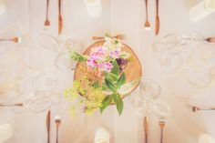 Rustic flower table centerpices with wild flowers. Floral designer Klara Uhlirova.