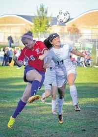 Camille Bowen goes up for a header against a Cornwall player on Oct. 18. The girls varsity soccer team grabbed the Division III championship.