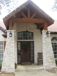 Our new house AFTER  Vaulted cedar ceiling, tapered stacked stone columns