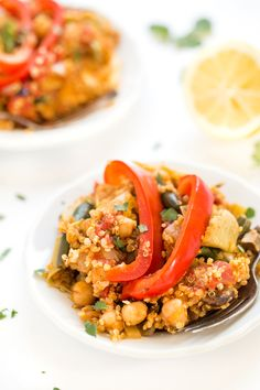 This easy vegetable paella is made in just one pan and ready in less than 40 minutes! Made vegetarian, but can easily be made with seafood or chicken too!