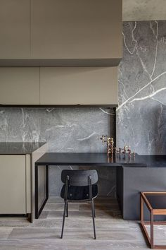 gorgeous marble and dark muted colors, would make a beautiful bar space, or even home office.