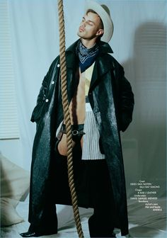 Front and center, Denek Kania wears a Dries Van Noten coat, Raf Simons shirt, and K Bar J Leather chaps. He also rocks David Samuel Menkes underwear with a hat and boots by Angels.