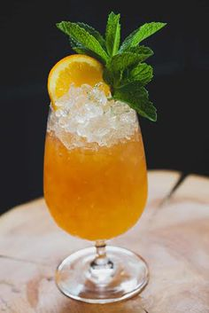 """""""South Of The Border"""" - Zacapa Rum 23, Myers Dark Rum, Orange Curaçao, Perfect Puree Passion Fruit, Fresh Lime Juice, Orgeat Syrup, Aromatic Bitters, Mint Sprig & Orange Slice for Garnish"""