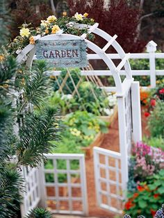 Make an entrance. one easy way to dress up a garden of any sort is to give it a grand entrance. here, a simple white arbor bedecked with climbing roses does