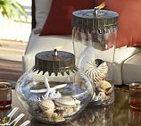 Oil Lamp with shells-this would actually be very easy and cheap to make as a dinner table centerpiece or even a beach themed wedding centerpiece