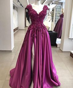 This purple cap sleeve formal dress can be used for a number of occasions. We make custom #eveningdresses and #weddingdresses. Creating #replicas are also an option. Email us for pricing.
