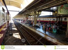 Photo about Thai travelers sit on a train platform waiting for their train to arrive in the modern station in Thailand. Image of arrive, platform, corner - 114192451 Ayutthaya Thailand, Train Platform, Train Station, Railroad Tracks, Asia, Modern, Travel, Image, Trendy Tree