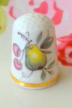 Hey, I found this really awesome Etsy listing at https://www.etsy.com/listing/234438168/vintage-antique-porcelain-pears-thimble