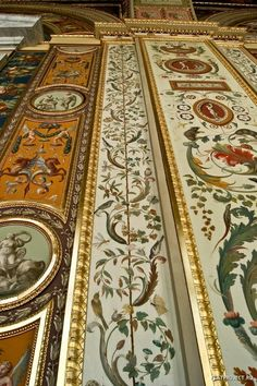 Interior of The Hermitage,Museum, formerly the Winter Palace~ St Petersburg, Russia~ Elaborately painted and gilded vertical panels line the walls