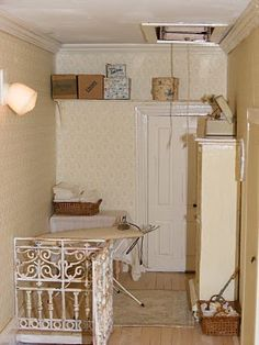 Inspiration - staging for ironing board, boxes etc in dollhouse laundrey room | Source: La Petite Sofie