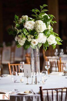 Classic wedding centerpiece idea - tall, glass centerpiece with white floral + greenery arrangement {Plum Sage Flowers}