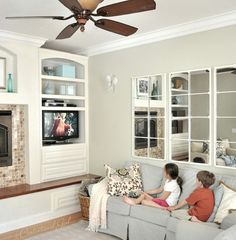Like the three mirrors (Ballard designs) painted and over a couch. Really opens a room up! - from Centsational Girl blog