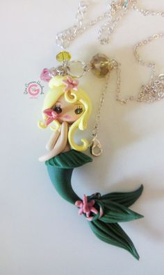 Kawaii Mermaid charm, Polymer clay  Mermaid charm, Girls Mermaid Charm, Handmade Mermaid, Girls jewelry, Yellow, Green and Pink Mermaid by GinaCarrascoHandmade on Etsy https://www.etsy.com/listing/191456048/kawaii-mermaid-charm-polymer-clay