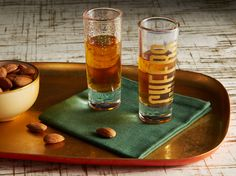 Vintage-inspired barware, like these gilded glasses, add a timelessly elegant touch.