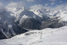 Dombay,  Karachay-Cherkess Republic, Russia.  While some may be headed toward Sochi for the Olympics, those looking to get away from the hoopla can head to Dombay for unbelievable views of the Caucasus Mountains and enough snow to keep most people content.