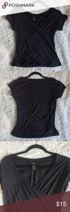 Express Black Wrap Short Sleeve Top This Express Black Wrap Top is perfect for any season. In the spring/summer, pair with some shorts and your favorite black sandals to keep cool and stylish. In the fall/winter, later the top with a jacket and throw on your favorite boyfriend jeans and boots to give a classy look with comfort.  The top is a size small and made off 90% nylon and 10% spandex. The material is thick and not see-through at all. Willing to negotiate 🌹 Express Tops Tees - Short…