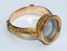 Miniature Telescopic Ring  A French gold ring, circa 1820, which opens up to reveal a so-called Galilean telescope with a combination of a convex or converging lens and a dispersing lens.