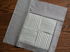 Quilt block with pleating.  Neutral colors with texture. Very fashion forward. :)
