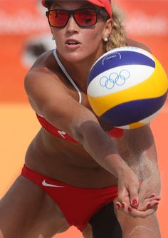Switzerland's Anouk Verge-Depre passes a ball during a women's beach volleyball…