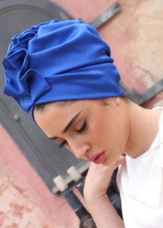 ready-to-wear Elegant fan-top turban in blue royal Silky Satin. Great for evening-wear or special events. The turban is stretchy, light, and easy to wear! No tying involved, this turban is worn like a hat. Can be worn as a full or half head covering-