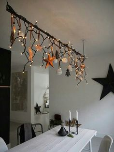 icicle lights, ornaments on suspended branch or dowel