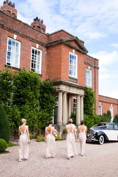 Bridesmaids arriving at Iscoyd Park in beautiful full length dresses