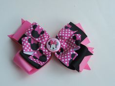 5 inch Minnie Mouse stacked bow with pinwheel top by Marysbowsnboards on Etsy
