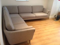 Jasmine corner sofa combination (2 seat sofa left arm + corner + 3 seat sofa right arm).  Oak legs and grey-beige col 4 fabric from the supplier's selection.