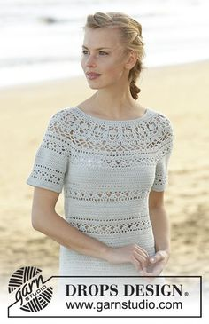 Dress crochet from the top down with round yoke, lace pattern and short sleeves in DROPS Safran. Size: S - XXXL Free pattern by DROPS Design.