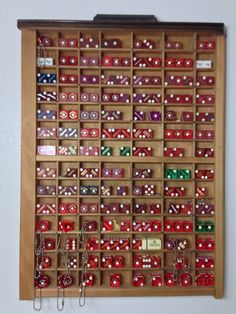 Neat wall mounted cabinet for displaying a dice collection