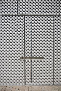 Expanded metal mesh - slightly more transparent than this design but the idea is similar for safety gates...