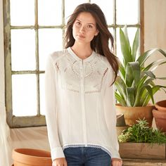 """CELINE BLOUSE--With its laser-cut bib and embroidered details, our nearly sheer blouse is patterned on Irish linens. Silk crinkle chiffon with high-low hemline, mandarin collar, shell buttons. Imported. Dry clean. Sizes XS (2), S (4 to 6), M (8 to 10), L (12 to 14), XL (16). 24-3/4""""L in front, 29-1/4""""L in back."""