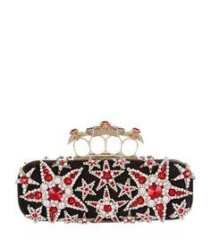 ALEXANDER MCQUEEN Embellished Stars Knuckle Duster Clutch. #alexandermcqueen #bags #leather #clutch #silk #hand bags #