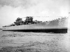 USS ASTORIA in the Delaware River shortly after launching.  Note the absence of gun turrets, masts, and much of her superstructure. -photo from NARA Records Group 80-G